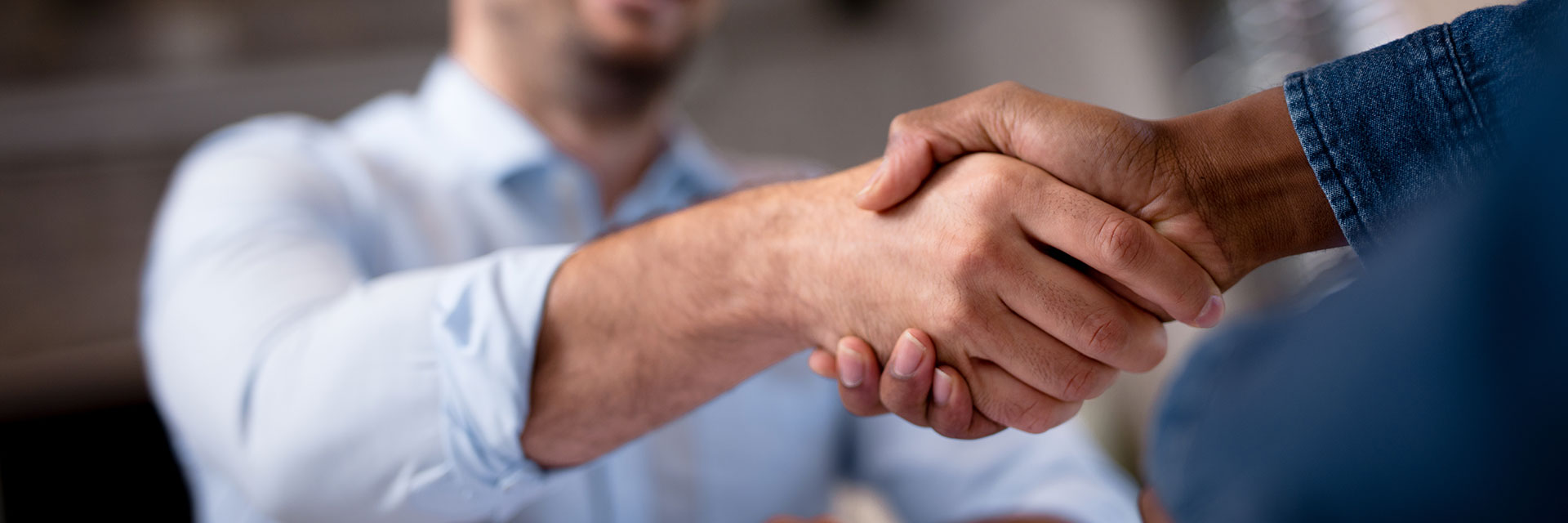 Insurance agent shaking hands with a customer